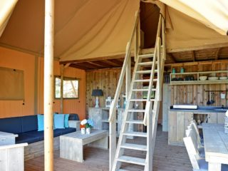 YALA_Glamping_Lodges_interior_with_living_room_and_kitchen_landscape