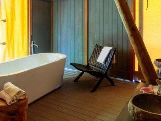 YALA_Supernova_bathroom_with_furniture_landscape - Safari tents and glamping lodges